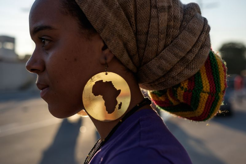 A protester wearing earrings with the image of the continent of Africa takes part in the International March Against the Genocide of Black People in Rio de Janeiro on Aug. 22, 2014.